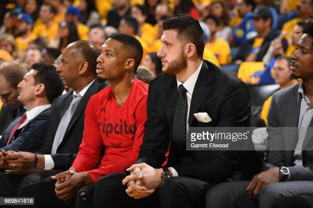 Jusuf Nurkic and Damian Lillard of the Portland Trail Blazers sit on the bench before the Western Conference Quarterfinals game against the Golden...