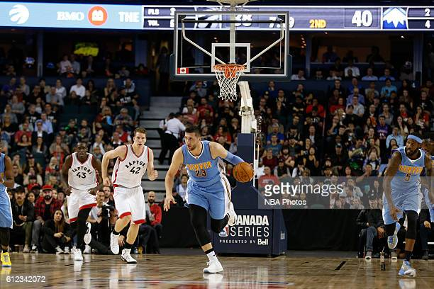 Jusuf Nurkic of the Denver Nuggets handles the ball against the Toronto Raptors on October 3 2016 at the Scotiabank Saddledome in Calagary Alberta...