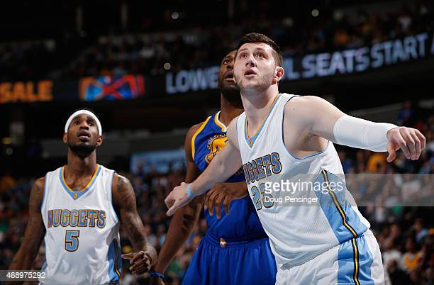 Jusuf Nurkic of the Denver Nuggets looks for a rebound against the Golden State Warriors at Pepsi Center on March 13 2015 in Denver Colorado The...