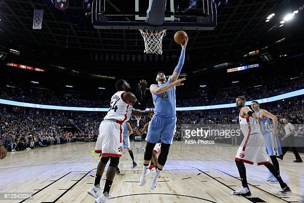 Jusuf Nurkic of the Denver Nuggets shoots the ball against the Toronto Raptors on October 3 2016 at the Scotiabank Saddledome in Calagary Alberta...