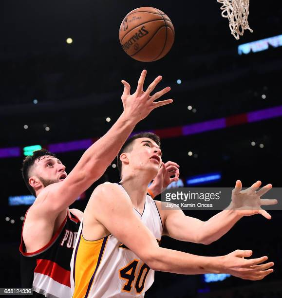 Jusuf Nurkic of the Portland Trail Blazers and Ivica Zubac of the Los Angeles Lakers battle for a rebound in the second half of the game at Staples...