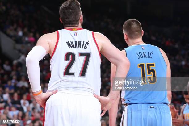 Jusuf Nurkic of the Portland Trail Blazers and Nikola Jokic of the Denver Nuggets look on on March 28 2017 at the Moda Center in Portland Oregon NOTE...