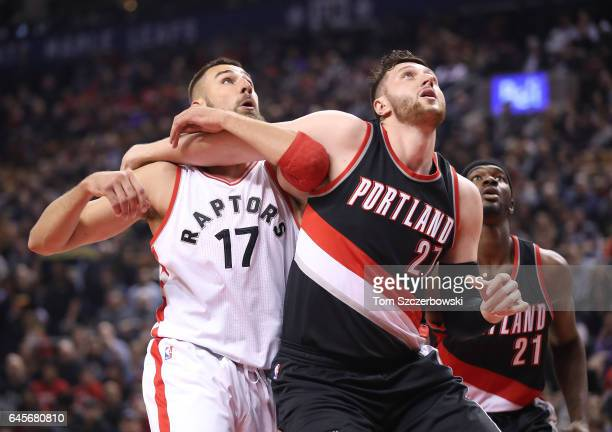 Jusuf Nurkic of the Portland Trail Blazers battles for position under the basket against Jonas Valanciunas of the Toronto Raptors during NBA game...