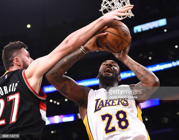 Jusuf Nurkic of the Portland Trail Blazers blocks a shot by Tarik Black of the Los Angeles Lakers the first half of the game against the Portland...