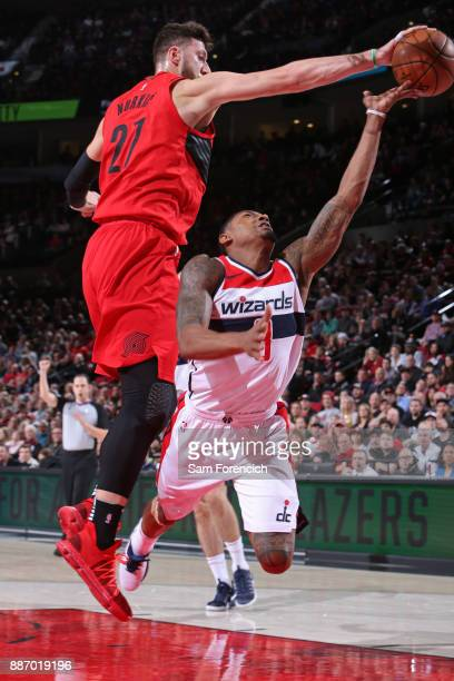 Jusuf Nurkic of the Portland Trail Blazers blocks the shot of Bradley Beal of the Washington Wizards on December 5 2017 at the Moda Center in...