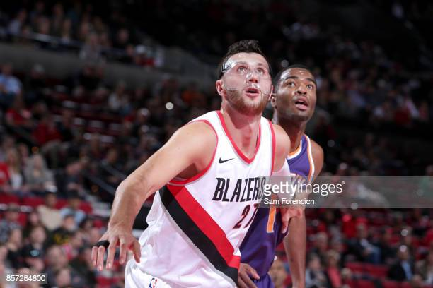 Jusuf Nurkic of the Portland Trail Blazers boxes out against TJ Warren of the Phoenix Suns on October 3 2017 at the Moda Center in Portland Oregon...