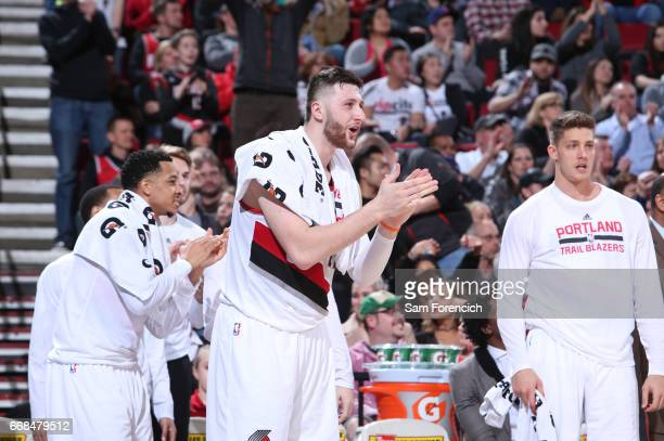 Jusuf Nurkic of the Portland Trail Blazers cheers on his teammates during the game against the Denver Nuggets on March 28 2017 at the Moda Center in...