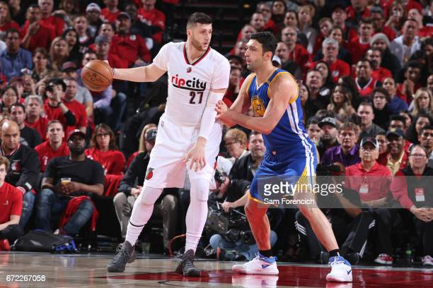 Jusuf Nurkic of the Portland Trail Blazers dribbles the ball while guarded by Zaza Pachulia of the Golden State Warriors in Game Three of the Western...