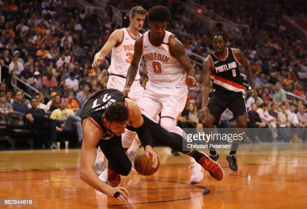 Jusuf Nurkic of the Portland Trail Blazers falls over the ball during the second half of the NBA game against the Phoenix Suns at Talking Stick...