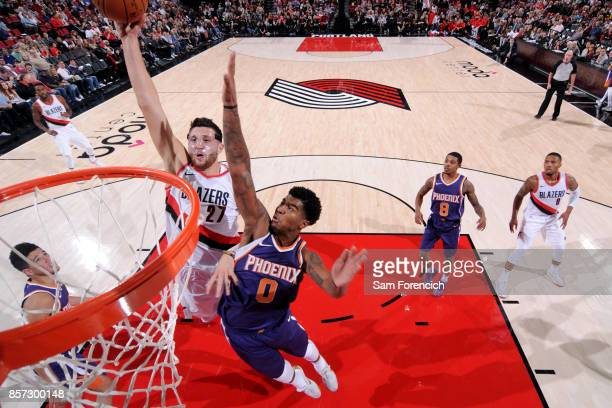 Jusuf Nurkic of the Portland Trail Blazers goes to the basket against the Phoenix Suns on October 3 2017 at the Moda Center in Portland Oregon NOTE...