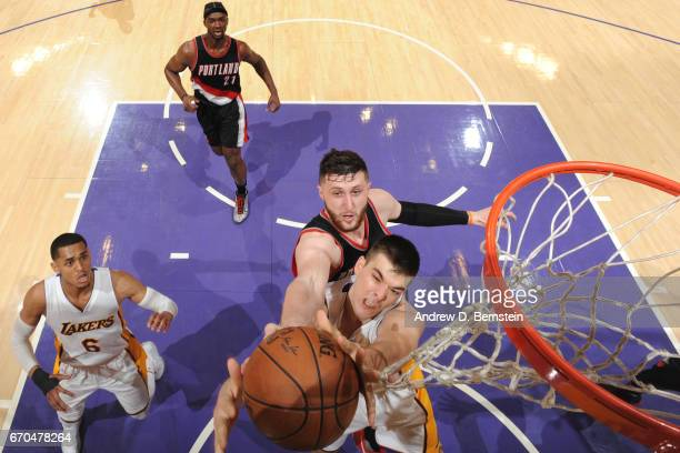 Jusuf Nurkic of the Portland Trail Blazers goes up for a rebound against Ivica Zubac of the Los Angeles Lakers on March 26 2017 at STAPLES Center in...