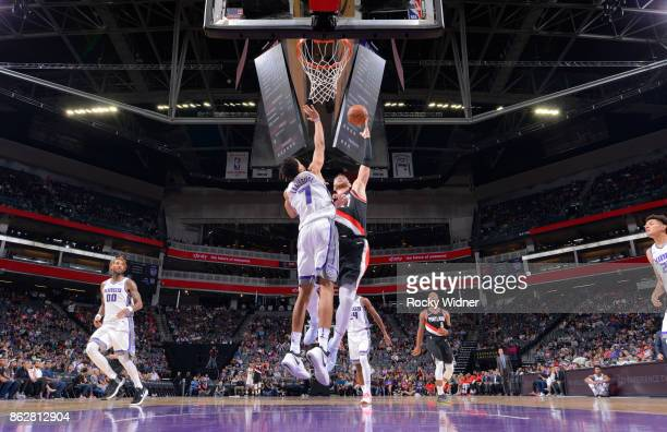Jusuf Nurkic of the Portland Trail Blazers goes up for the shot against Skal Labissiere of the Sacramento Kings on October 9 2017 at Golden 1 Center...