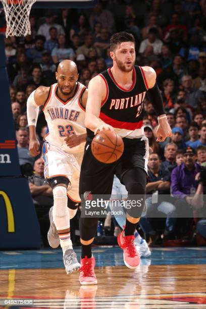Jusuf Nurkic of the Portland Trail Blazers handles the ball against Taj Gibson of the Oklahoma City Thunder during the game on March 7 2017 at...