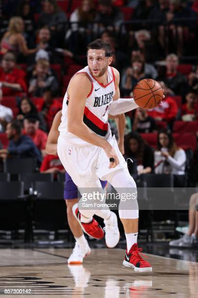 Jusuf Nurkic of the Portland Trail Blazers handles the ball against the Phoenix Suns on October 3 2017 at the Moda Center in Portland Oregon NOTE TO...