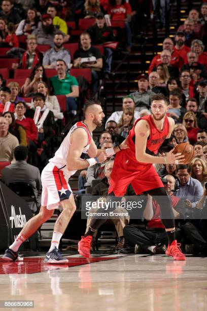Jusuf Nurkic of the Portland Trail Blazers handles the ball against Marcin Gortat of the Washington Wizards on December 5 2017 at the Moda Center in...