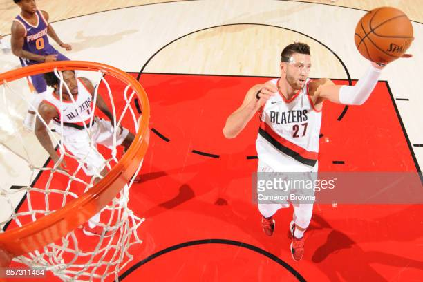 Jusuf Nurkic of the Portland Trail Blazers handles the ball during a preseason game against the Phoenix Suns on October 3 2017 at the Moda Center in...