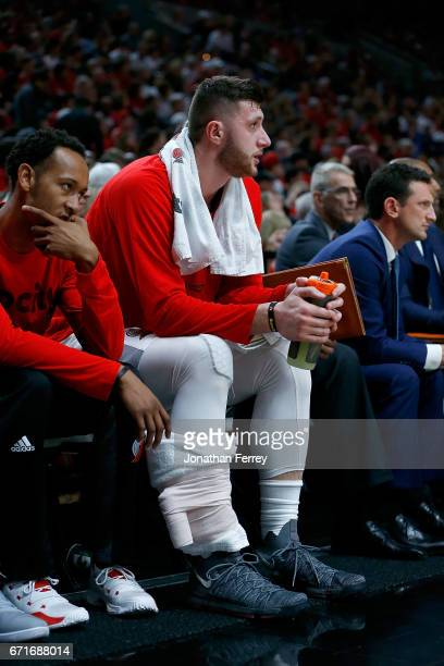 Jusuf Nurkic of the Portland Trail Blazers ices his leg on the bench against the Golden State Warriors during Game Three of the Western Conference...