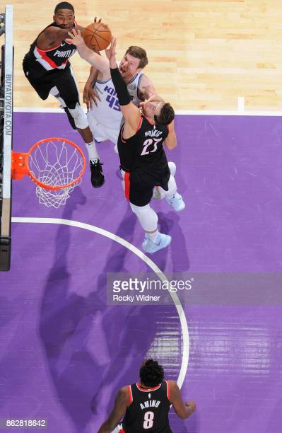 Jusuf Nurkic of the Portland Trail Blazers rebounds against Jack Cooley of the Sacramento Kings on October 9 2017 at Golden 1 Center in Sacramento...