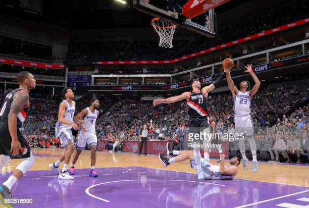 Jusuf Nurkic of the Portland Trail Blazers rebounds against Malachi Richardson of the Sacramento Kings on October 9 2017 at Golden 1 Center in...