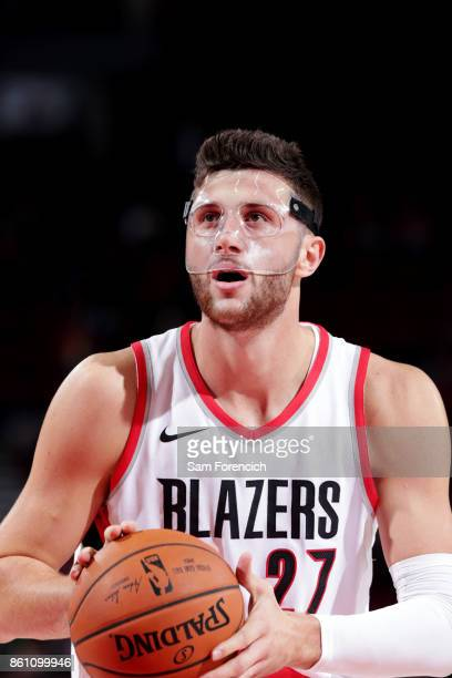 Jusuf Nurkic of the Portland Trail Blazers shoots a free throw during the preseason game against the Maccabi Haifa on October 13 2017 at the Moda...