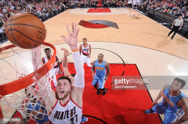 Jusuf Nurkic of the Portland Trail Blazers shoots a lay up during the game against the Denver Nuggets on March 28 2017 at the Moda Center in Portland...