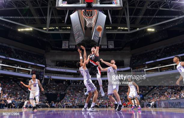 Jusuf Nurkic of the Portland Trail Blazers shoots a layup against the Sacramento Kings on October 9 2017 at Golden 1 Center in Sacramento California...