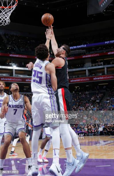 Jusuf Nurkic of the Portland Trail Blazers shoots against Justin Jackson of the Sacramento Kings on October 9 2017 at Golden 1 Center in Sacramento...