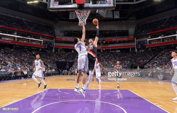 Jusuf Nurkic of the Portland Trail Blazers shoots against Skal Labissiere of the Sacramento Kings on October 9 2017 at Golden 1 Center in Sacramento...