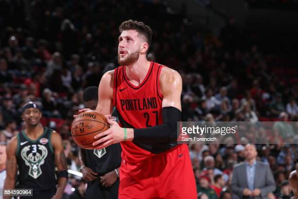 Jusuf Nurkic of the Portland Trail Blazers shoots the ball against the Milwaukee Bucks on November 30 2017 at the Moda Center Arena in Portland...