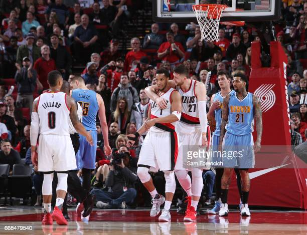 Jusuf Nurkic talks with CJ McCollum of the Portland Trail Blazers during the game against the Denver Nuggets on March 28 2017 at the Moda Center in...