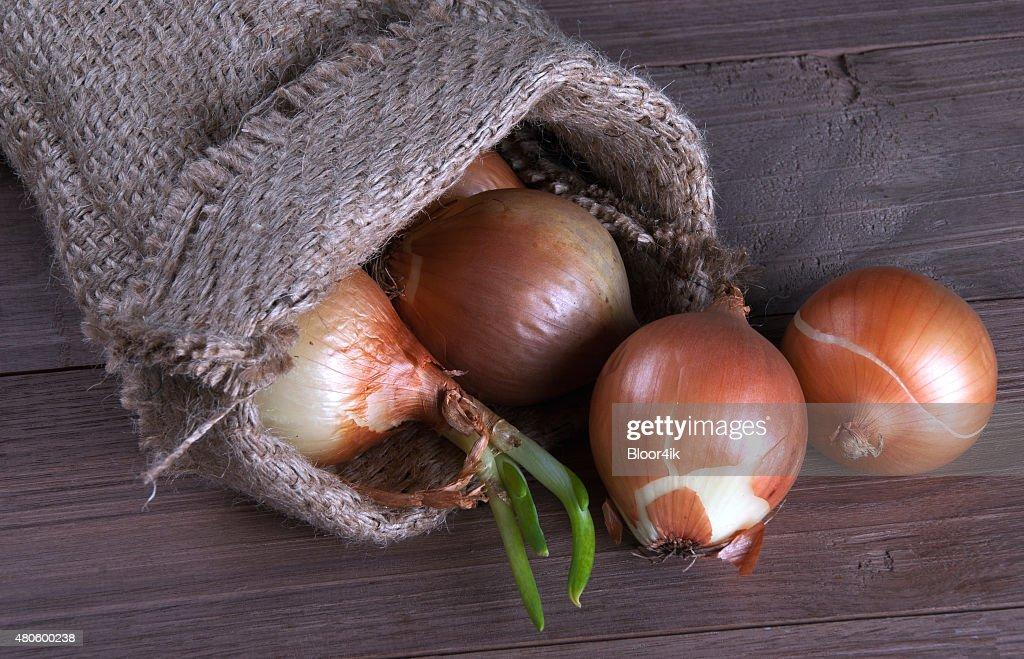 Jute sack with  onions : Stock Photo