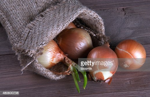 Jute sack with  onions : Stock Photo