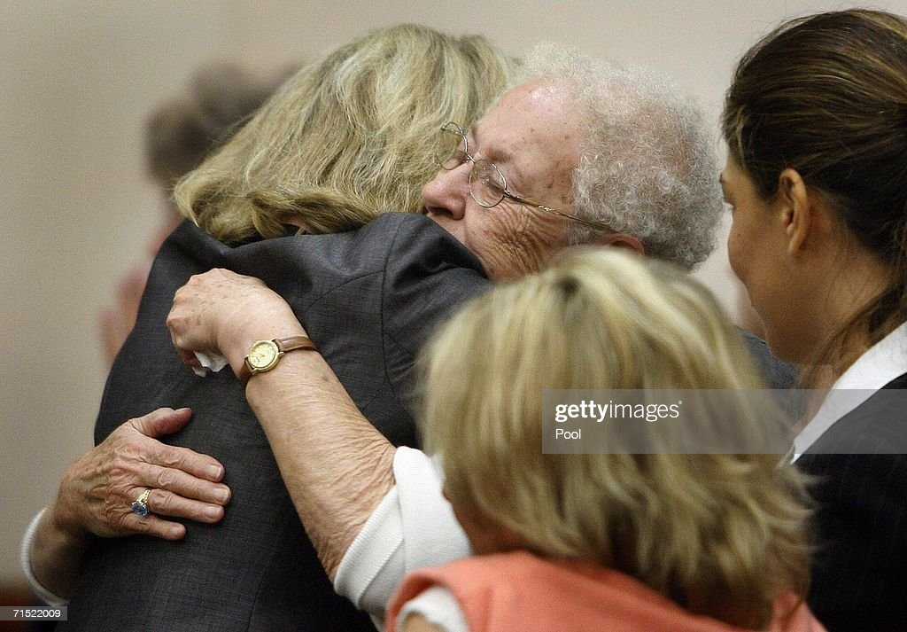 Jutta Karin Kennedy (C) is congratulated by supporters following the not guilty by reason of insanity verdict in daughter Andrea Yates' retrial July 26, 2006 in Houston. Yates admits to drowning her five children in a bath tub in 2001 and pleaded guilty by reason of insanity.