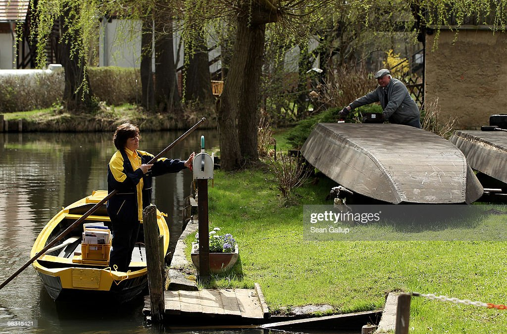 Jutta Pudenz an employee of German postal carrier Deutsche Post DHL arrives to deliver mail from her faltbottomed canoe in the narrow canals in the...