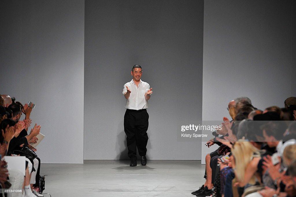 Juun J acknowledges the audience during the Juun J show as part of Paris Fashion Week Menswear Spring/Summer 2015 on June 27, 2014 in Paris, France.