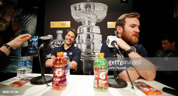 Juuse Saros and Yannick Weber of the Nashville Predators answer questions during Media Day for the 2017 NHL Stanley Cup Final at PPG Paints Arena on...