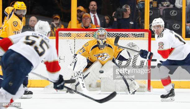 Juuse Saros of the Nashville Predators and Reilly Smith of the Florida Panthers eye the shot of Jason Demers during an NHL game at Bridgestone Arena...