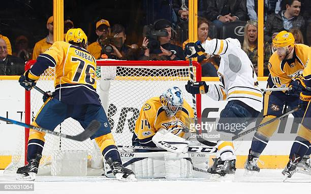 Juuse Saros of the Nashville Predators blocks a shot of Brian Gionta of the Buffalo Sabres during an NHL game at Bridgestone Arena on January 24 2017...