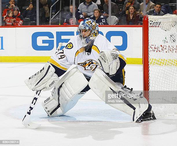 Juuse Saros of the Nashville Predators defends his net against the New Jersey Devils during the game at Prudential Center on December 20 2016 in...