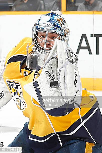 Juuse Saros of the Nashville Predators makes a glove save against the Boston Bruins during an NHL game at Bridgestone Arena on January 12 2017 in...