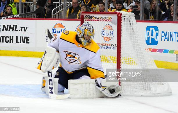 Juuse Saros of the Nashville Predators makes a glove save against the Pittsburgh Penguins at PPG PAINTS Arena on October 7 2017 in Pittsburgh...
