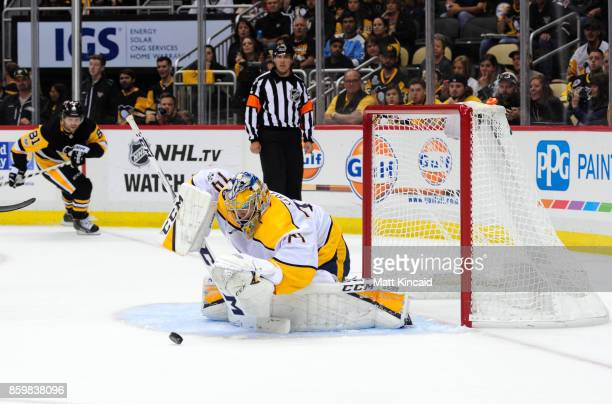 Juuse Saros of the Nashville Predators makes a save against the Pittsburgh Penguins at PPG PAINTS Arena on October 7 2017 in Pittsburgh Pennsylvania