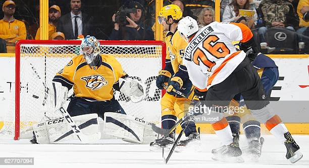 Juuse Saros of the Nashville Predators makes the save against Chris VandeVelde of the Philadelphia Flyers during an NHL game at Bridgestone Arena on...