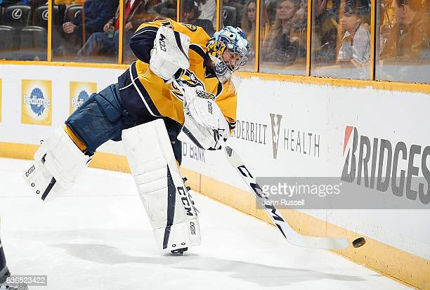 Juuse Saros of the Nashville Predators plays the puck against the New York Rangers during an NHL game at Bridgestone Arena on December 17 2016 in...