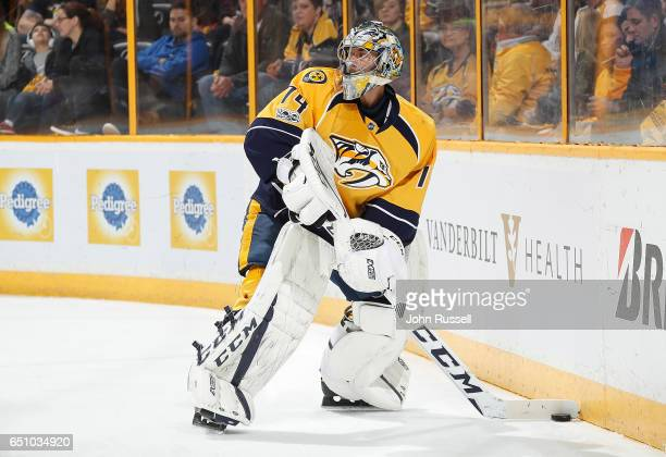 Juuse Saros of the Nashville Predators plays the puck against the Chicago Blackhawks during an NHL game at Bridgestone Arena on March 4 2017 in...