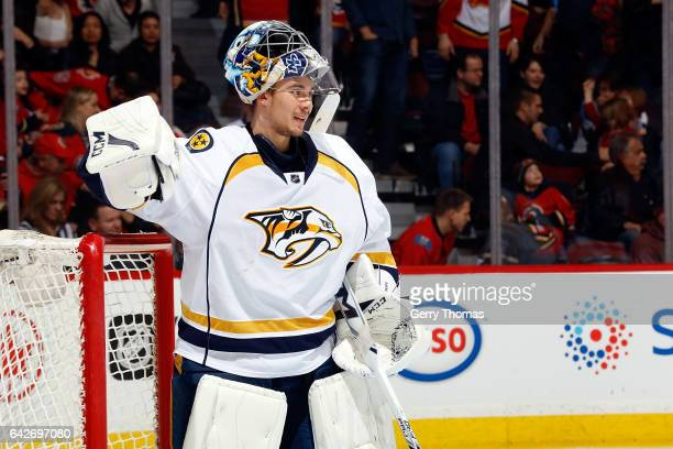 Juuse Saros of the Nashville Predators skates against the Calgary Flames during an NHL game on January 19 2017 at the Scotiabank Saddledome in...