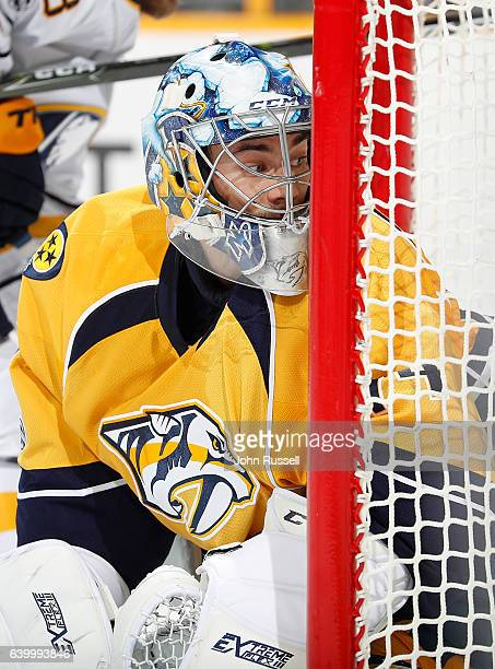 Juuse Saros of the Nashville Predators tends net against the Buffalo Sabres during an NHL game at Bridgestone Arena on January 24 2017 in Nashville...