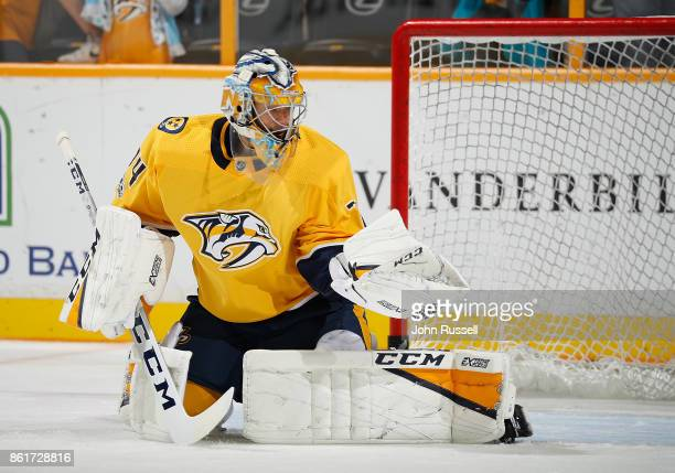 Juuse Saros of the Nashville Predators warms up in net against the Dallas Stars during an NHL game at Bridgestone Arena on October 12 2017 in...