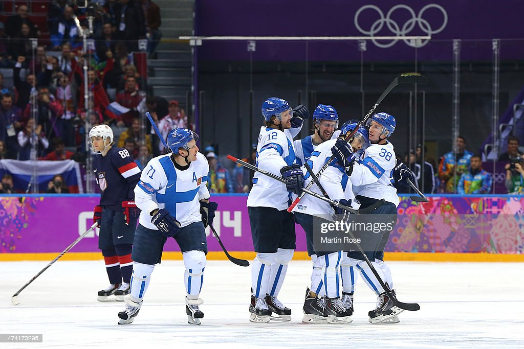 Juuso Hietanen #38 of Finland celebrates his third period goal with Leo Komarov #71, Sami Lepisto #18, Olli Jokinen #12 and Tuomo Ruutu #15 in the second period against the United States during the Men's Ice Hockey Bronze Medal Game on Day 15 of the 2014 Sochi Winter Olympics at Bolshoy Ice Dome on February 22, 2014 in Sochi, Russia.