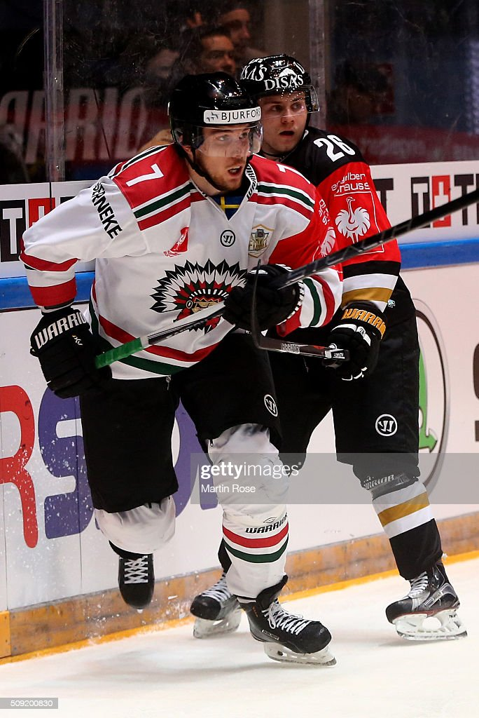 Juuso Ikonen #26 of Oulu and Henrik Tommernes #7 of Gothenburg battle for the puck during the Champions Hockey League final game between Karpat Oulu and Frolunda Gothenburg at Oulun Energia-Areena on February 9, 2016 in Oulu, Finland.